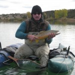 pontoon boat angler with brown trout
