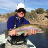 angler showing large rainbow trout