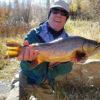 angler with trophy tiger trout