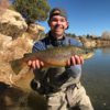 Angler with large brown trout
