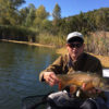 Fly fisher with large tiger trout